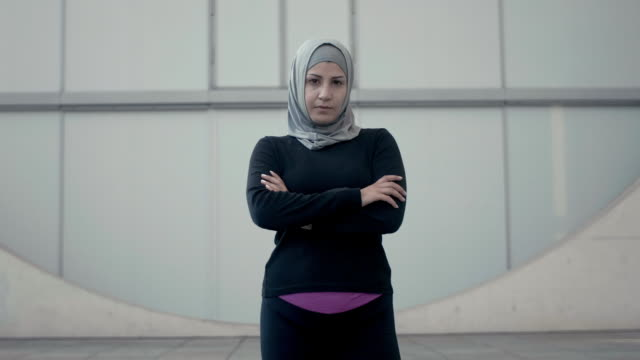 portrait of a sporty muslim woman in hijab (slow motion) - headscarf stock videos & royalty-free footage