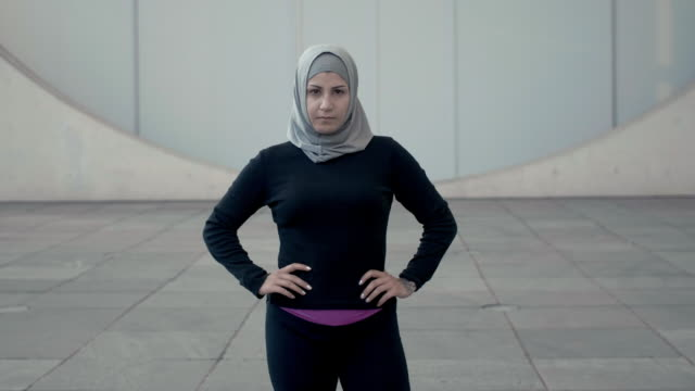 portrait of a sporty muslim woman in hijab (slow motion) - hijab stock videos and b-roll footage