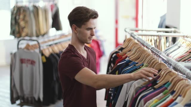 portrait of a store manager in clothing store - armeria negozio video stock e b–roll