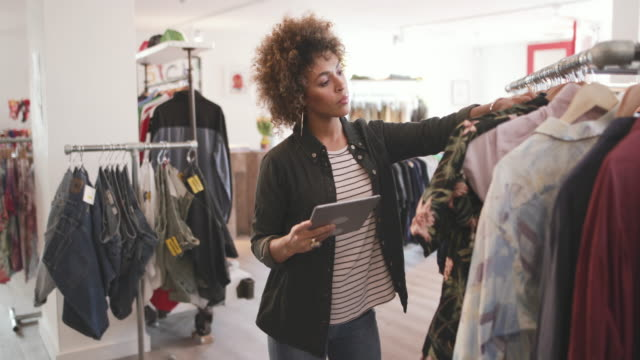 portrait of a store manager in clothing store - boutique stock videos & royalty-free footage