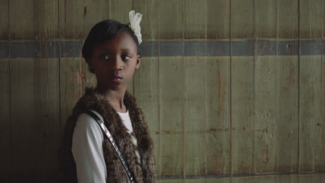 portrait of a strong african-american girl looking away from the camera - only girls stock videos & royalty-free footage