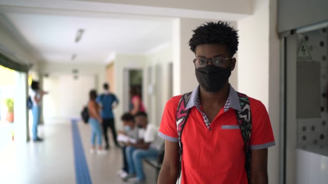 portrait of a student wearing face mask at school's patio - lifestyle stock videos & royalty-free footage