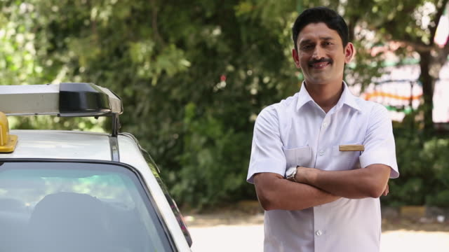 Portrait of a taxi driver smiling, Delhi, India