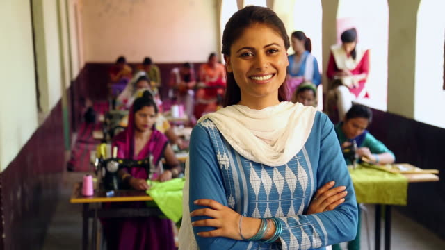 Portrait of a teacher standing in tailoring class, Sonipat, Haryana, India