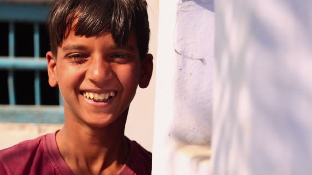 portrait of a teenage boy laughing, ballabhgarh, haryana, india - only teenage boys stock videos & royalty-free footage