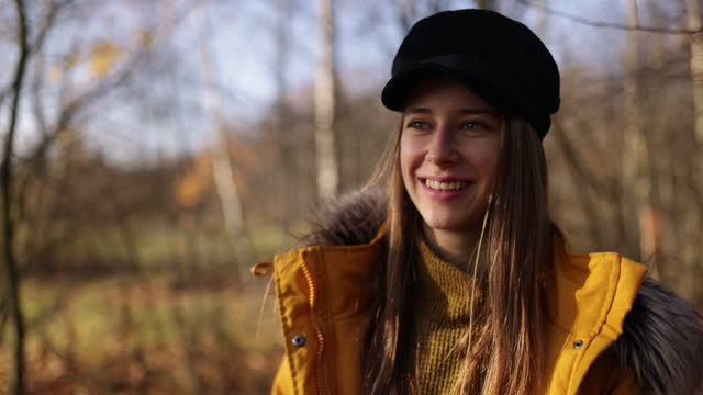 portrait of a teenage girl hiking in autumn forest - one teenage girl only stock videos & royalty-free footage