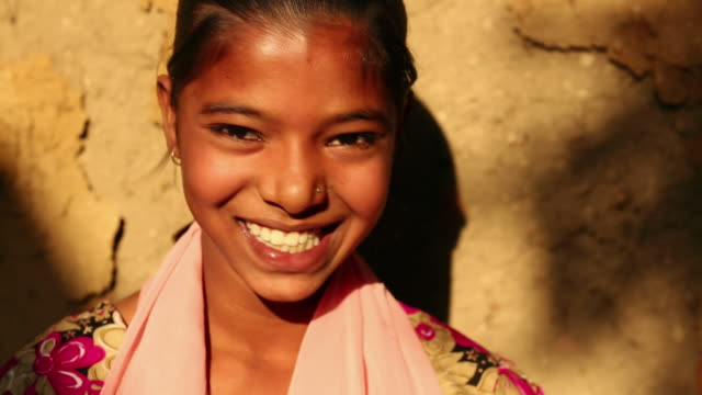 portrait of a teenage girl laughing, ballabhgarh, haryana, india - インド人点の映像素材/bロール