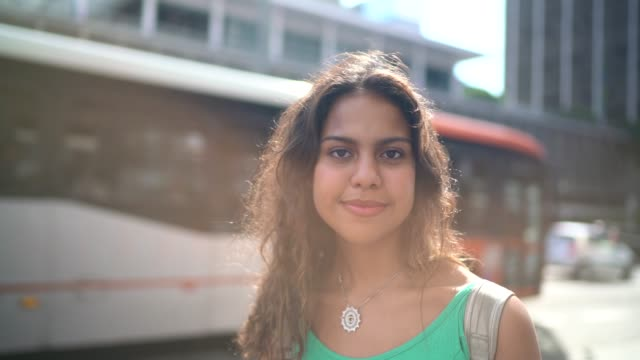 portrait of a teenager girl at city - standing out from the crowd stock videos & royalty-free footage