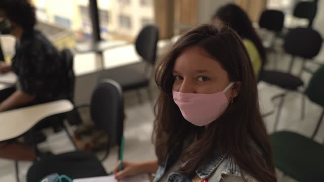 portrait of a teenager girl wearing face mask studying at school - lifestyle stock videos & royalty-free footage
