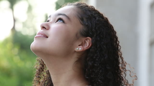 portrait of a teenager looking up. - content stock videos & royalty-free footage