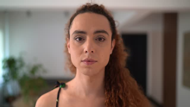 portrait of a transgender woman at home - gender stereotypes stock videos & royalty-free footage