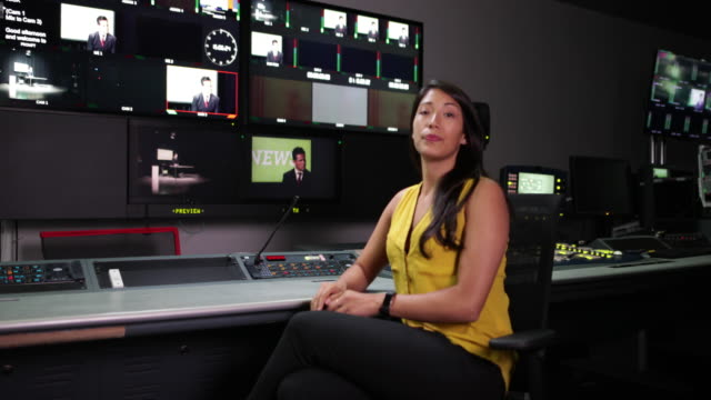 portrait of a tv producer in a control room - control点の映像素材/bロール