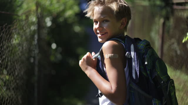 portrait of a vaccinated teenage boy going to school - 12 13 years stock videos & royalty-free footage