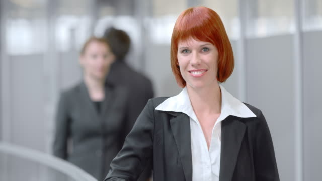 slo mo portrait of a vibrant young business woman - one mid adult woman only stock videos & royalty-free footage