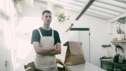 Portrait of a waiter and delivery food on the counter
