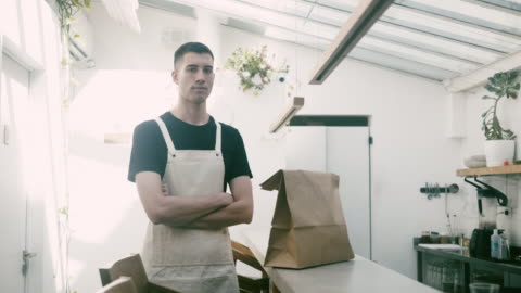 portrait of a waiter and delivery food on the counter - fast food stock videos & royalty-free footage