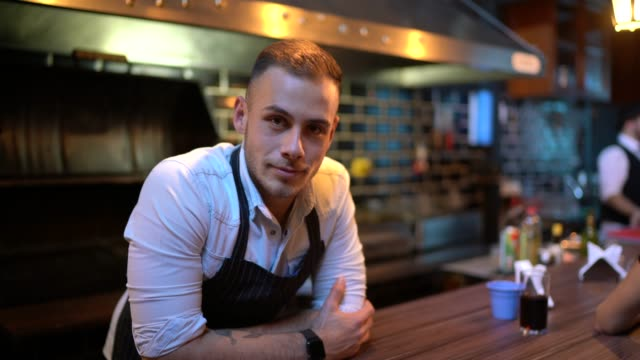 portrait of a waiter behind the counter - chef stock videos & royalty-free footage
