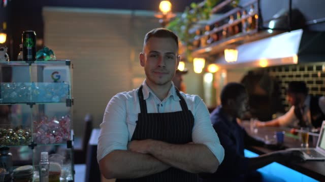 portrait of a waiter standing with arms crossed - opening event stock videos & royalty-free footage