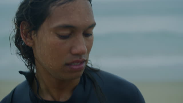 portrait of a wet surfer - solo man stock videos and b-roll footage