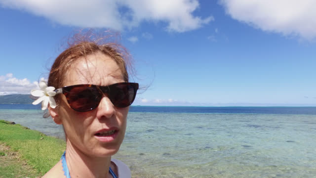 portrait of a woman by the sea - tahaa island stock videos & royalty-free footage