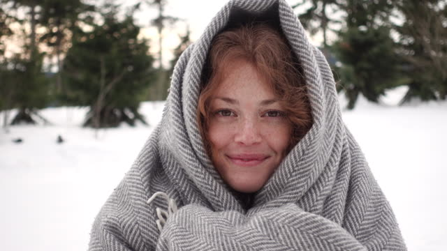 portrait of a woman covered in a blanket - material stock videos and b-roll footage