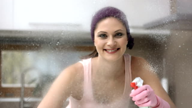 hd dolly: portrait of a woman doing housework - protective glove stock videos & royalty-free footage