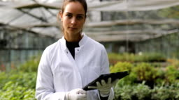 Portrait of a woman farming researcher in greenhouse