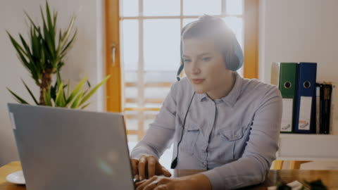 ds portrait of a woman from a call centre working from home - headset stock videos & royalty-free footage
