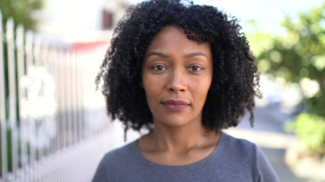 portrait of a woman in the street - african american ethnicity stock videos & royalty-free footage