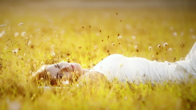 DS Portrait of a woman lying in grass