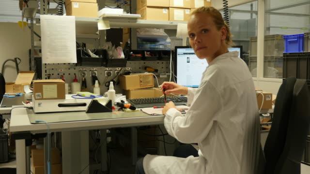 Portrait of a woman technician in her electronics workshop