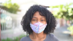 Portrait of a woman with face mask at street