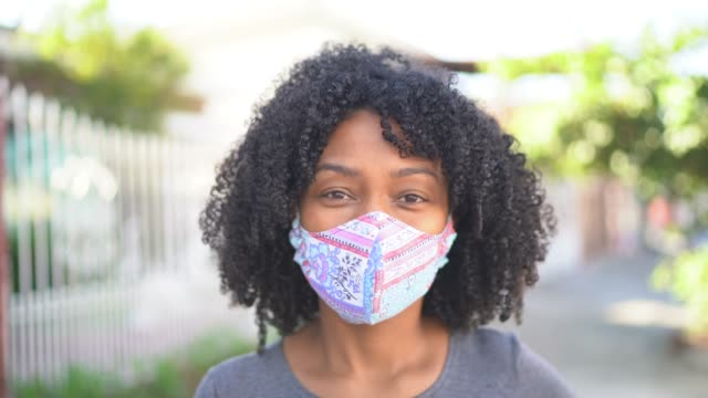 portrait of a woman with face mask at street - females stock videos & royalty-free footage