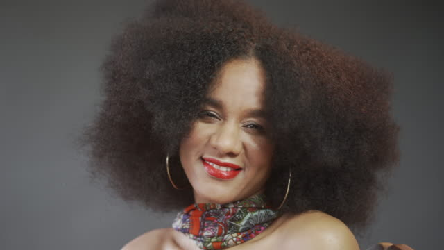 a portrait of a woman with natural afro hair after a full makeover - natural hair stock videos & royalty-free footage