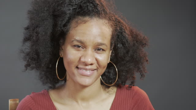 a portrait of a woman with natural afro hair and no make-up - no make up stock videos & royalty-free footage