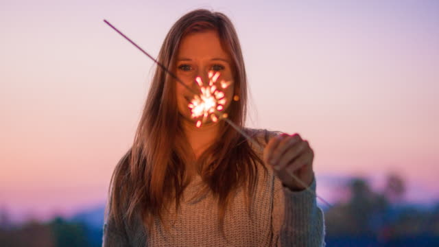 Portrait of a woman with sparkler