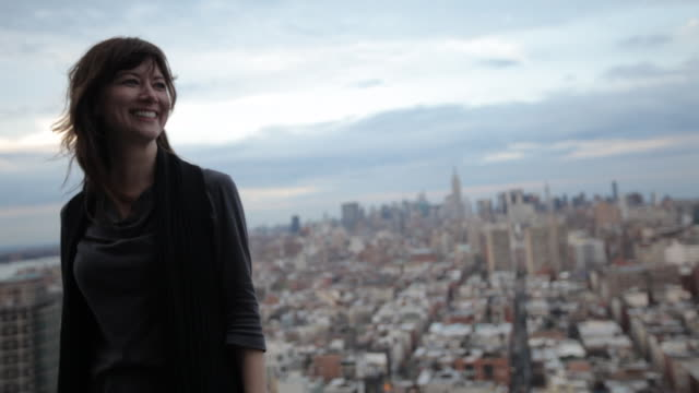 portrait of a woman woman on a rooftop overlooking Manhattan