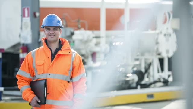 TS Portrait of a worker in fuelling depot