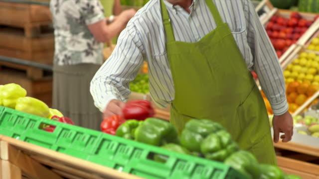 HD: Portrait Of A Worker In Greengrocer'S Shop