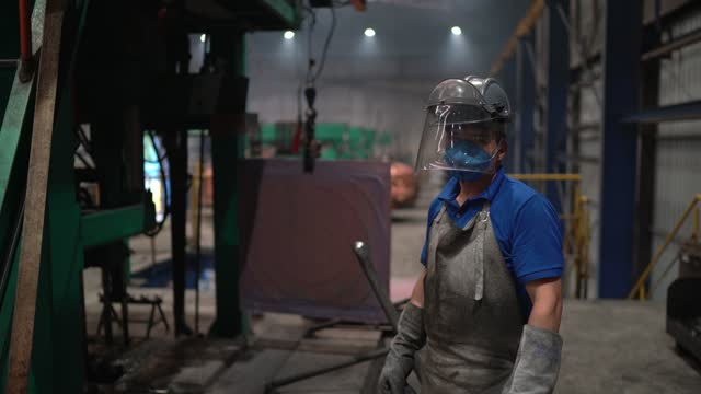 portrait of a worker wearing welding helmet in a metal industry - welding helmet stock videos & royalty-free footage