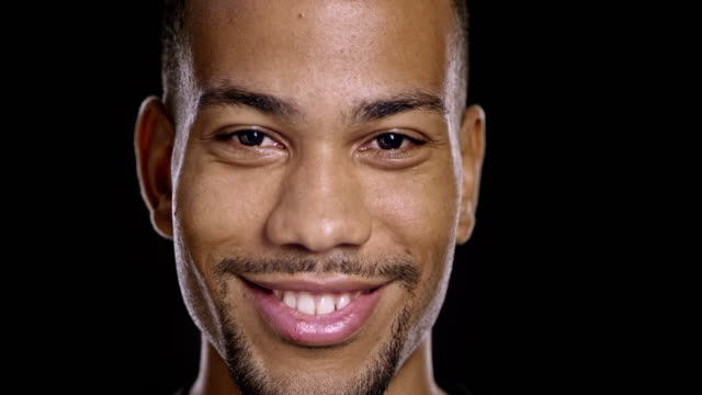 portrait of a young african-american male smiling - close up stock videos & royalty-free footage