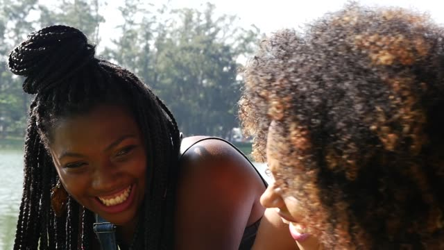 portrait of a young afro woman in the park - joy stock videos & royalty-free footage