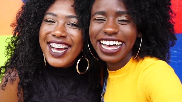 portrait of a young best friends laughing - laughing stock videos & royalty-free footage