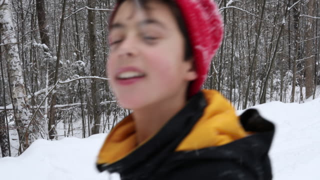 stockvideo's en b-roll-footage met portrait of a young boy heading off to sled with friends - muts