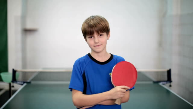 portrait of a young boy holding a table tennis racket - championships stock videos & royalty-free footage