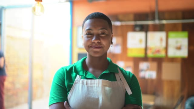 portrait of a young business owner standing in front of restaurant with arms crossed - pardo brazilian stock videos & royalty-free footage