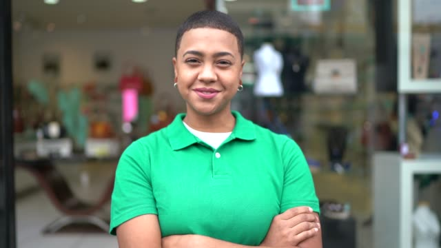 portrait of a young business owner standing with arms crossed in front of a store - shaved stock videos & royalty-free footage