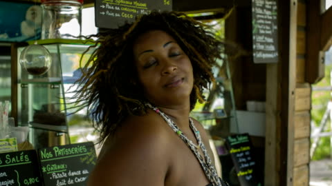 portrait of a young caribbean woman in a bar in martinique - one mid adult woman only stock videos & royalty-free footage