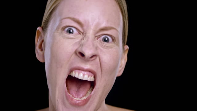 portrait of a young caucasian woman screaming - mouth open stock videos and b-roll footage