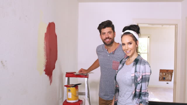 Portrait of a young couple in their home mid renovation.
